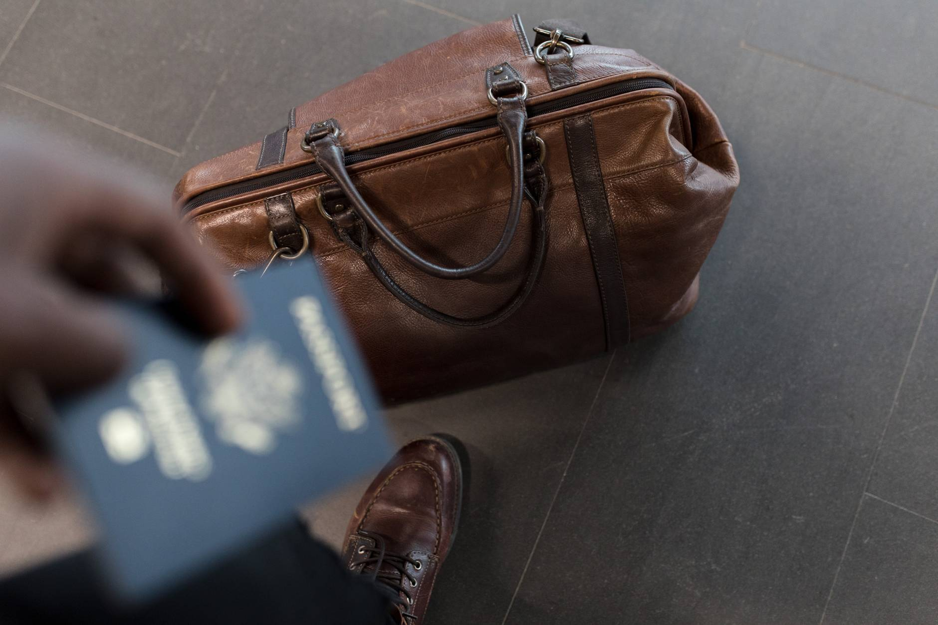 Man with passport and bag