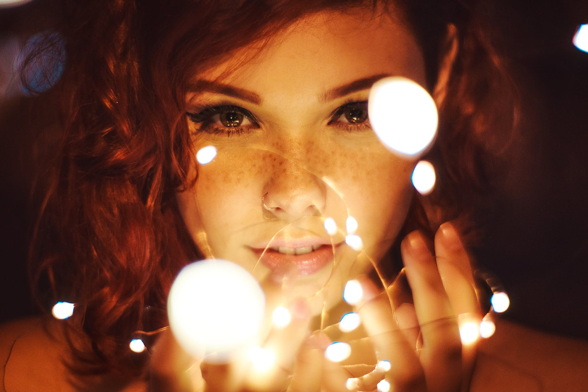 Stargirl lets her light shine photography of a woman holding lights